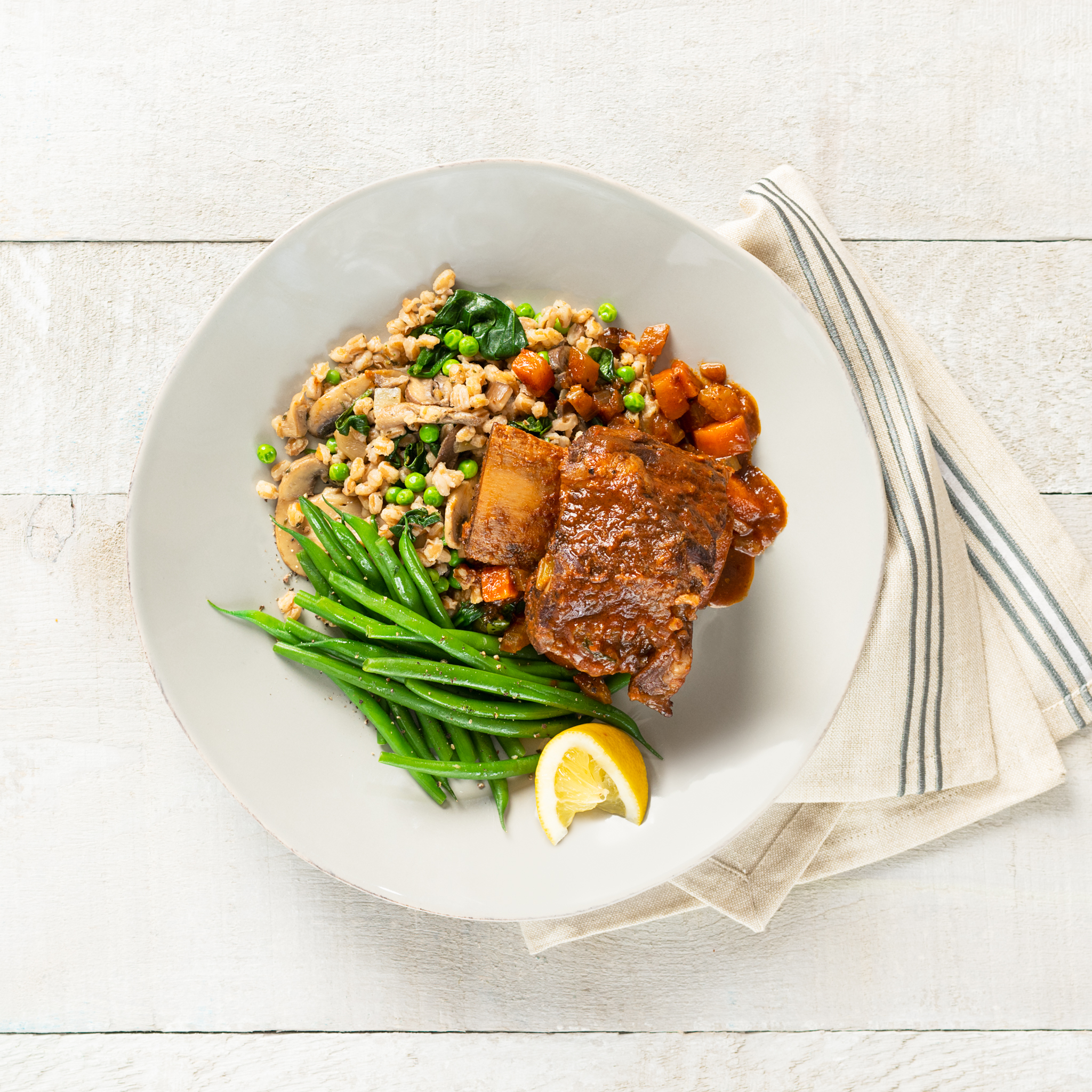 Tuscan braised short ribs with spinach & mushroom farro pilaf